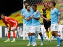 Manchester City's Raheem Sterling celebrates with teammates after scoring against Watford on July 21, 2020