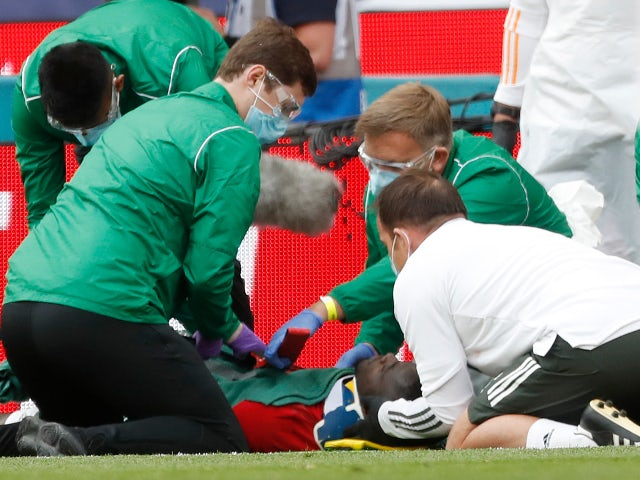 Manchester United defender Eric Bailly gets fitted with a neck brace after being injured on July 19, 2020