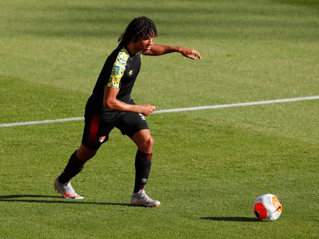 Bournemouth defender Nathan Ake warms up before the game on July 12, 2020