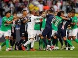 Paris Saint-Germain and Saint-Etienne players fight in the Coupe de France final on July 24, 2020