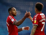 Britt Assombalonga celebrates scoring for Middlesbrough with James Tavernier on July 22, 2020