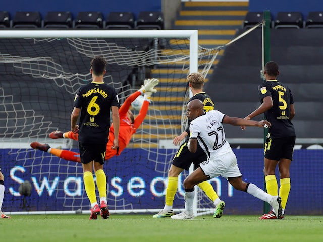 Swansea City's Andre Ayew scores against Brentford in the first leg of their Championship playoff semi-final on July 26, 2020