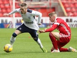 Aberdeen's Dean Campbell in action with Rangers's Ryan Kent in the Scottish Premiership on August 1, 2020