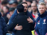 Chelsea manager Frank Lampard and Arsenal boss Mikel Arteta hug in December 2019