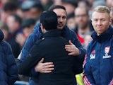 Chelsea manager Frank Lampard and Arsenal boss Mikel Arteta hug in December 2019