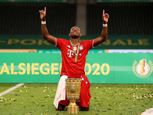 Bayern Munich's David Alaba pictured with the DFB-Pokal trophy in July 2020