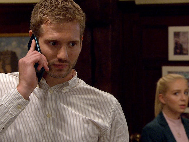Jamie takes a call on Emmerdale on July 27, 2020