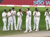England players celebrate Stuart Broad's 500th Test wicket on July 28, 2020