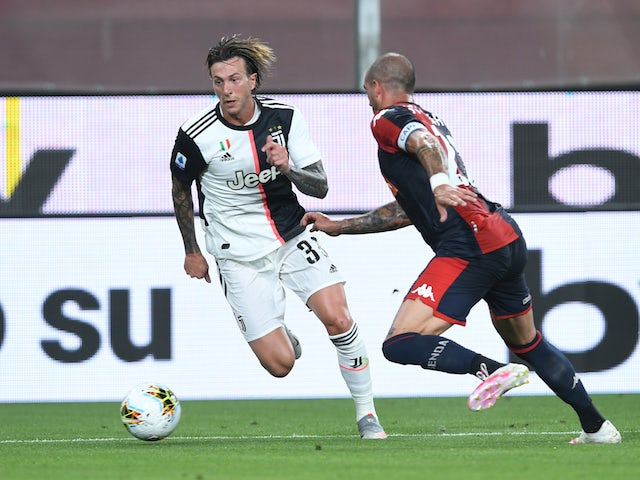 Juventus's Federico Bernardeschi in action with Genoa's Stefano Sturaro in Serie A on June 30, 2020