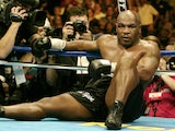 Mike Tyson on the canvas after being knocked out by Danny Williams in July 2004