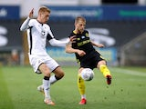 Swansea City's Jay Fulton in action with Brentford's Mathias Jensen in the Championship playoffs on July 26, 2020