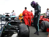 Lewis Hamilton looks at his tyre puncture during the British Grand Prix on August 2, 2020