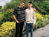Alex George and his younger brother Llyr