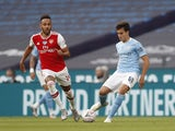 Arsenal's Pierre-Emerick Aubameyang in action with Manchester City's Eric Garcia in the FA Cup on July 18, 2020
