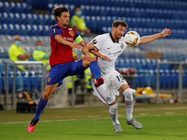 Basel's Valentin Stocker in action with Eintracht Frankfurt's David Abraham in the Europa League on August 6, 2020