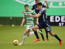 Celtic's Ryan Christie in Scottish Premiership action with Hamilton Academical's Shaun Want on August 3, 2020