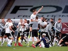 Fulham players and staff celebrate in the Championship playoff final on August 4, 2020