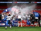 Fulham players celebrate winning promotion to the Premier League on August 4, 2020