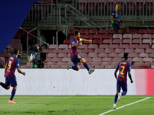 Barcelona's Lionel Messi celebrates scoring against Napoli in the Champions League on August 8, 2020