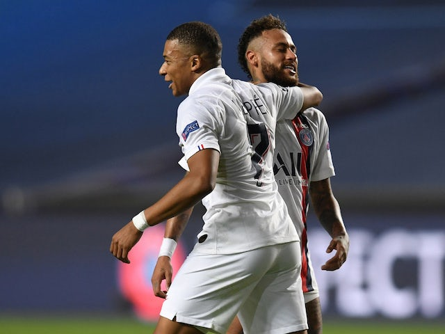 Paris Saint-Germain's Neymar and Kylian Mbappe celebrate overcoming Atalanta BC in the Champions League on August 12, 2020