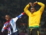 Great Britain's Mo Farah and Jamaica's Usain Bolt celebrate winning gold at the 2012 Olympics