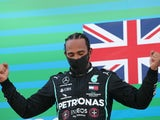 Lewis Hamilton celebrates after winning the Spanish Grand Prix on August 16, 2020