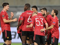 Manchester United players celebrate Bruno Fernandes's goal against Copenhagen on August 10, 2020