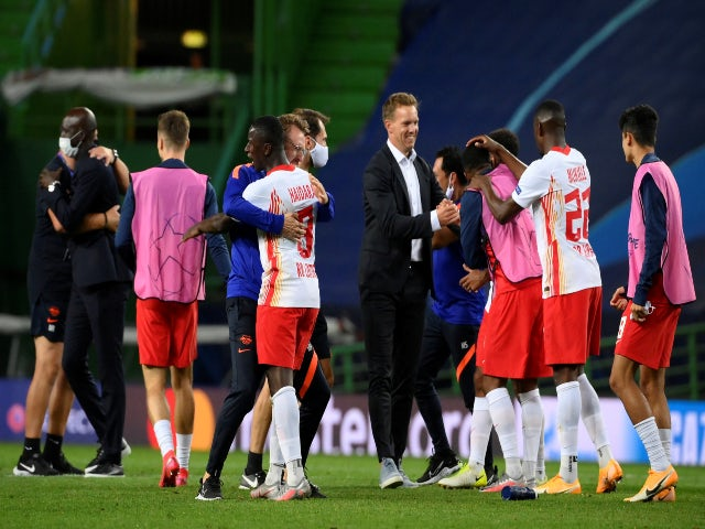RB Leipzig and Julian Nagelsmann celebrate reaching the Champions League semi-finals following victory over Atletico Madrid on August 13, 2020
