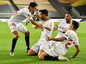 Sevilla players celebrate Suso's goal against Manchester United on August 16, 2020