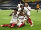 Sevilla players celebrate Lucas Ocampos's goal against Wolverhampton Wanderers on August 11, 2020