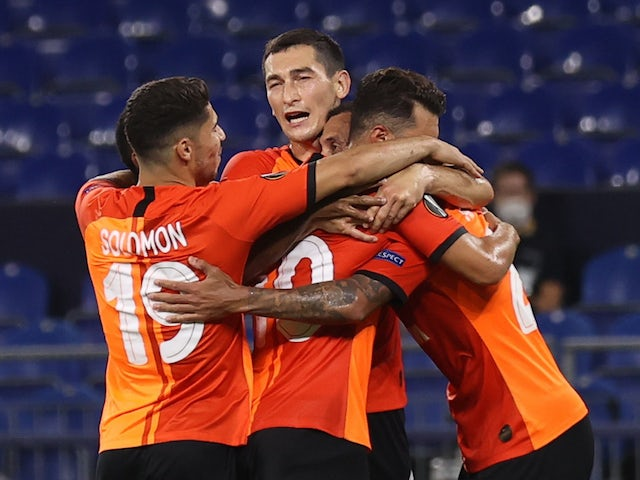 Shakhtar Donetsk's Alan Patrick celebrates with teammates after scoring against Basel on August 11, 2020
