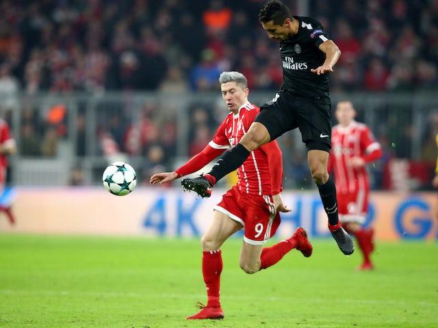 Paris Saint-Germain's Marquinhos in action with Bayern Munich's Robert Lewandowski in December 2017