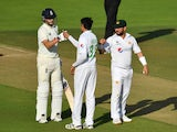 England and Pakistan players shake hands after drawing the second Test on August 17, 2020
