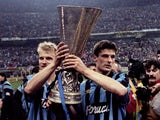 Inter Milan players Dennis Bergkamp and Wim Jonk celebrate with the UEFA Cup in 1994