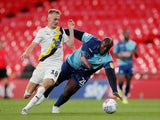 Oxford United's Mark Sykes in action with Wycombe Wanderers's Adebayo Akinfenwa in the League One playoff final on July 13, 2020