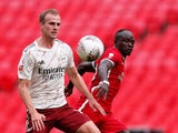 Arsenal's Rob Holding in action with Liverpool's Sadio Mane in the Community Shield on August 29, 2020