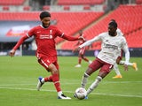 Liverpool's Joe Gomez in action with Arsenal's Ainsley Maitland-Niles during the Community Shield on August 29, 2020
