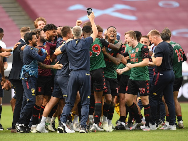Aston Villa players and staff celebrate avoiding relegation in July 2020