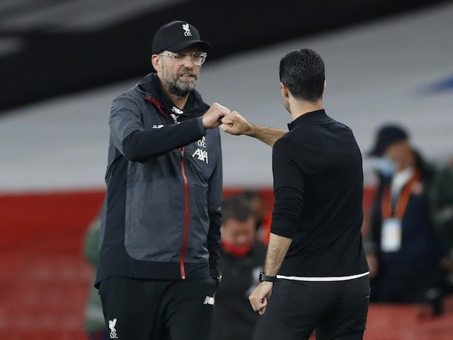 Liverpool manager Jurgen Klopp fist bumps Arsenal counterpart Mikel Arteta in July 2020