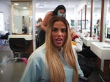 Katie Price in her pink wheelchair on a pampering day