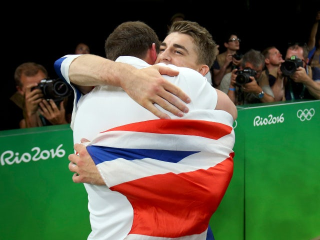 Gymnast Max Whitlock celebrates with coach Scott Hann at the Rio Olympics on August 14, 2016