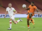 Netherlands's Memphis Depay in action with Poland's Kamil Glik in the UEFA Nations League on September 4, 2020