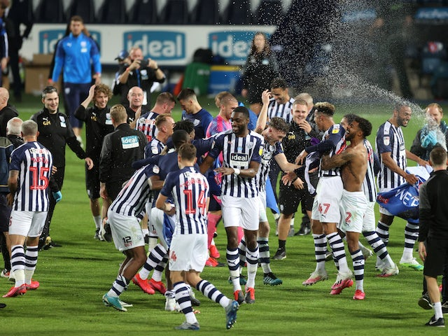 West Bromwich Albion players and staff celebrate winning promotion in 2019-20
