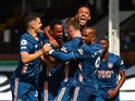 Arsenal players celebrate Gabriel Magalhaes goal against Fulham on September 12, 2020