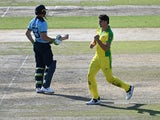 Australia's Pat Cummins celebrates taking the wicket of Jos Buttler on September 13, 2020