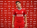 Kostas Tsimikas poses in a Liverpool kit in August 2020