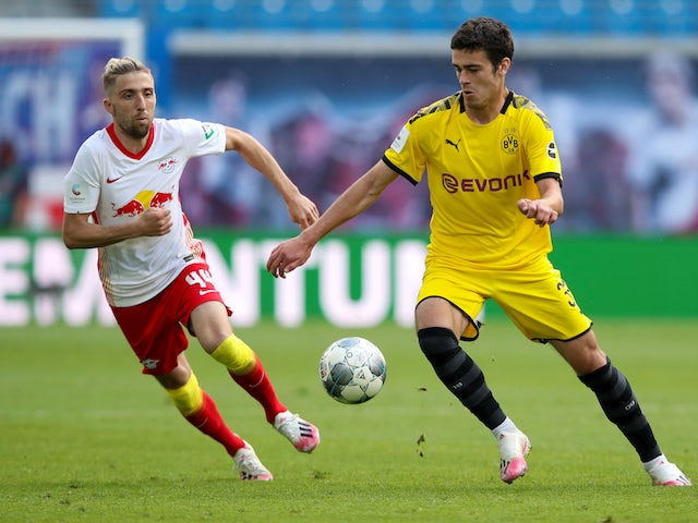Borussia Dortmund's Giovanni Reyna in action with RB Leipzig's Kevin Kampl in the Bundesliga on June 20, 2020