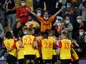 Lens celebrate scoring against Paris Saint-Germain in Ligue 1 on September 10, 2020