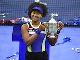 Naomi Osaka celebrates with the US Open trophy on September 13, 2020