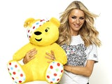 Tess Daly fondling Pudsey The Bear in plain sight